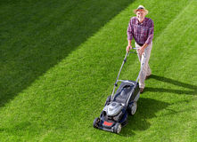 Mowing senior man Stock Photo