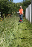 Mowing Weeds Stock Images