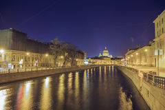 Moyka river by night and St. Isaac casidral. Stock Photo