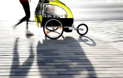 Moyther with yellow pram Royalty Free Stock Photography