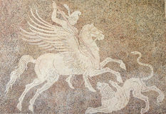 Mozaic of a horseman fighting a lion in Rhodes, Greece Royalty Free Stock Photos