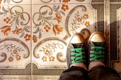 Mozaic and shoes. Tiles of ceramic and shoes Stock Photos