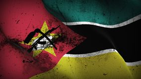 Mozambique grunge dirty flag waving on wind. Mozambican background fullscreen grease flag blowing on wind. Realistic filth fabric texture on windy day Royalty Free Stock Image