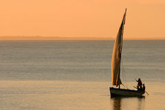 Mozambican dhow at sunset. Traditional sail boat called a dhow at sunset, Vilanculos coastal sanctuary, Mozambique Royalty Free Stock Photos