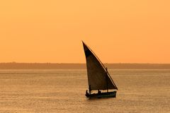 Mozambican dhow at sunset, Mozambique, Africa. Traditional sail boat (dhow) at sunset, Vilanculos, Mozambique, southern Africa Royalty Free Stock Images