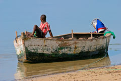 Mozambican fisherman. A mozambican fisherman sitting on a fishing boat Royalty Free Stock Photo