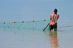 Mozambican fisherman, Mozambique, Southern Africa. A mozambican fisherman pulling a fishing net from the water, Mozambique, Southern Africa Stock Image