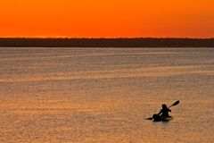 Mozambican sunset. Golden sunset with canoeist, Vilanculos coastal sanctuary, Mozambique Stock Images