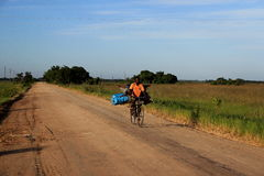 Mozambique Africa. Villagers use bicycle transport to travel and move barter goods between villages Royalty Free Stock Photo