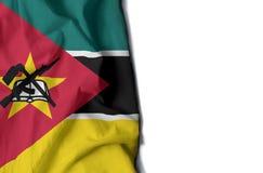 Mozambique arrugó la bandera, espacio para el texto Foto de archivo libre de regalías