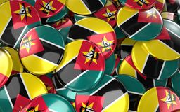 Mozambique Badges Background - Pile of Mozambican Flag Buttons. 3D Rendering Royalty Free Stock Images