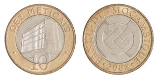 Mozambique coin meticals. Coin ten meticals Mozambique with the image of a building bank isolated on white background Stock Images