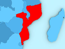 Mozambique on 3D map. Country of Mozambique highlighted in red on blue map. 3D illustration Royalty Free Stock Images