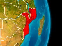 Mozambique on Earth. Mozambique in red on planet Earth with visible borderlines. 3D illustration. Elements of this image furnished by NASA Royalty Free Stock Images