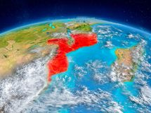 Mozambique on Earth. Orbit view of Mozambique highlighted in red on planet Earth with highly detailed surface textures. 3D illustration. Elements of this image Stock Photography