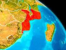 Mozambique on Earth. Space orbit view of Mozambique highlighted in red on planet Earth with visible borders. 3D illustration. Elements of this image furnished by Royalty Free Stock Photo