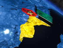 Mozambique with embedded flag from space. Mozambique with embedded national flag at night from space. 3D illustration with detailed planet surface and visible Royalty Free Stock Photo