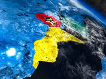 Mozambique with embedded flag from space. Mozambique with embedded national flag at night from space. 3D illustration with detailed planet surface and visible Royalty Free Stock Photos