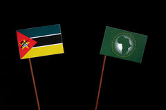 Mozambique flag with African Union flag isolated on black. Background Stock Photography