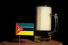 Mozambique flag with beer mug  on black. Background Royalty Free Stock Photo