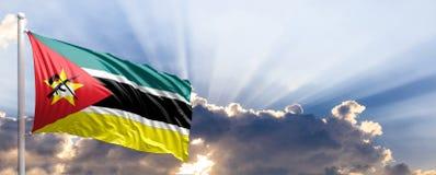 Mozambique flag on blue sky. 3d illustration. Mozambique waving flag on blue sky. 3d illustration Stock Images
