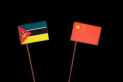 Mozambique flag with Chinese flag isolated on black. Background Royalty Free Stock Photography