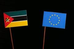 Mozambique flag with European Union EU flag  on black Royalty Free Stock Photos
