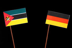Mozambique flag with German flag isolated on black. Background Royalty Free Stock Photo