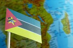 Mozambique flag with a globe map as a background Stock Images