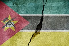 Mozambique   FLAG PAINTED ON CRACKED WALL NICE. Mozambique   FLAG PAINTED ON CRACKED WALL Stock Photo