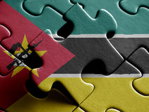 Mozambique FLAG PAINTED ON PUZZLE nice. Mozambique FLAG PAINTED ON PUZZLE Royalty Free Stock Photos