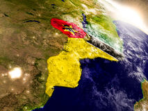 Mozambique with flag in rising sun Royalty Free Stock Photo