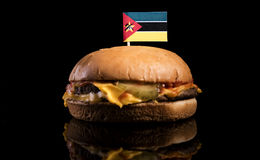 Mozambique flag on top of hamburger  on black. Background Royalty Free Stock Photography