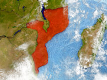 Mozambique on map with clouds. Mozambique in red on map with detailed landmass texture, realistic watery oceans and clouds above the surface. 3D illustration Stock Photo