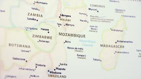 Mozambique on a Map. Mozambique on a political map of the world. Video defocuses showing and hiding the map stock footage