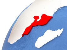 Mozambique on metallic globe with blue oceans Stock Images