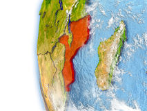Mozambique on model of Earth. Mozambique highlighted in red on planet Earth with visible waves in the oceans and clouds in the atmosphere. 3D illustration with Royalty Free Stock Images