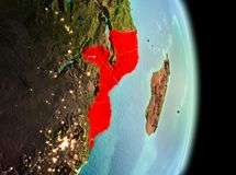 Mozambique in morning from orbit. Early morning view of Mozambique highlighted in red on planet Earth. 3D illustration. Elements of this image furnished by NASA Stock Image