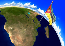 Mozambique national flag marking the country location on world map. 3D rendering, parts of this image furnished by NASA Royalty Free Stock Photo