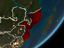 Mozambique on night Earth. Mozambique as seen from Earth's orbit on planet Earth at night highlighted in red with visible borders and city lights. 3D Royalty Free Stock Photography