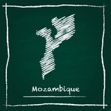 Mozambique outline vector map hand drawn with. Mozambique outline vector map hand drawn with chalk on a green blackboard. Chalkboard scribble in childish style Stock Photo