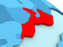Mozambique in red on blue globe Royalty Free Stock Photography