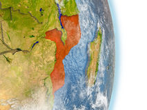 Mozambique in red on Earth Royalty Free Stock Image