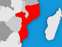 Mozambique in red on globe Stock Images