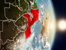 Mozambique during sunrise. Highlighted in red on planet Earth with visible country borders. 3D illustration. Elements of this image furnished by NASA Stock Images