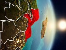 Mozambique during sunrise. Highlighted in red on planet Earth with visible country borders. 3D illustration. Elements of this image furnished by NASA Royalty Free Stock Image