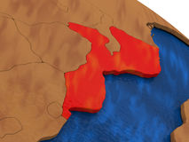 Mozambique on wooden globe Stock Image