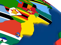 Mozambique and Zimbabwe on 3D map with flags Stock Photos