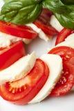 Mozarella. Basil and tomatoes on white Stock Photo