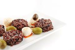 Mozarella cheese and dark rice Royalty Free Stock Photos